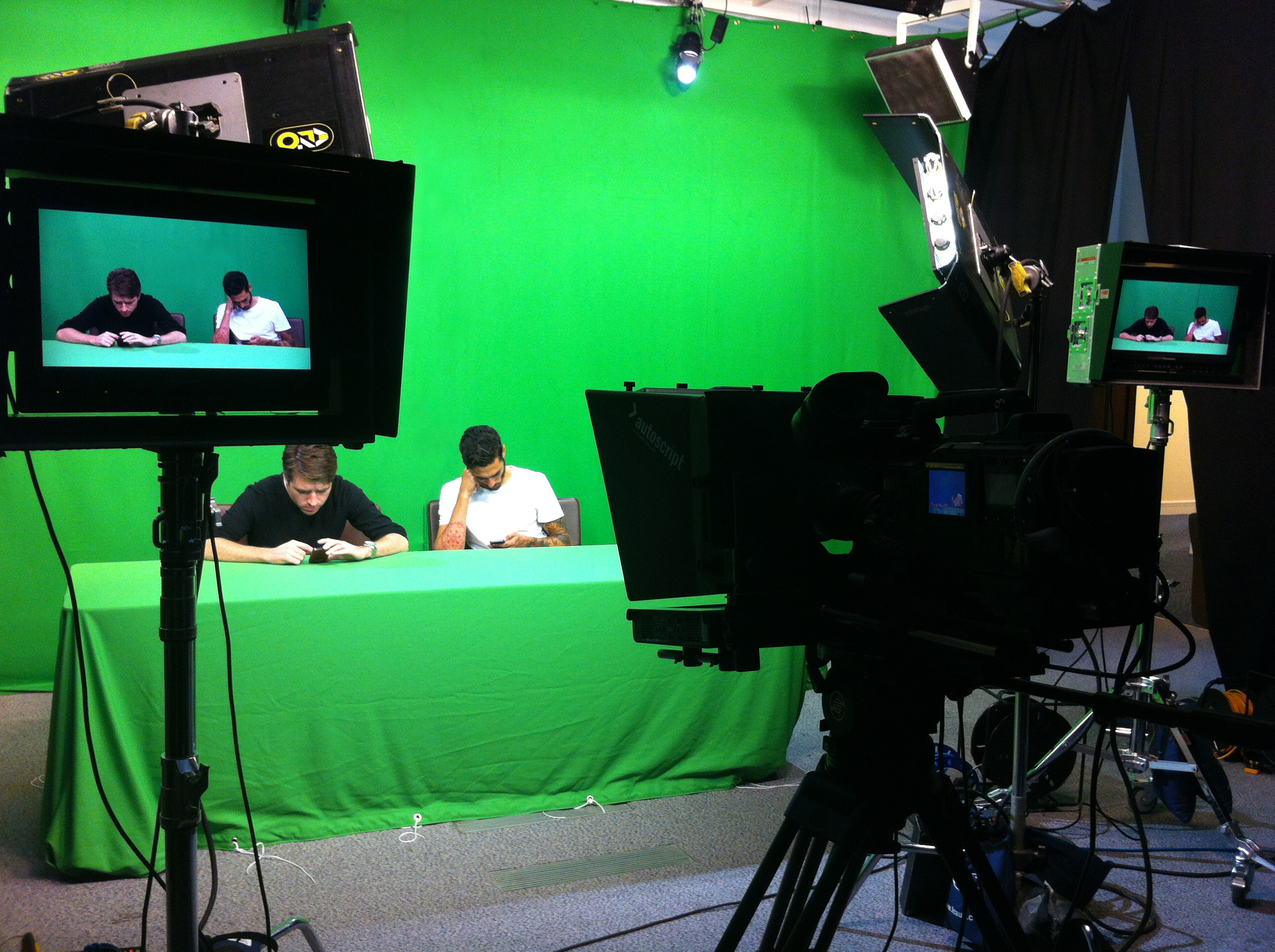 Green Screen Studio 2 at IQ Studios with Green Desk, camera, monitors and lights.
