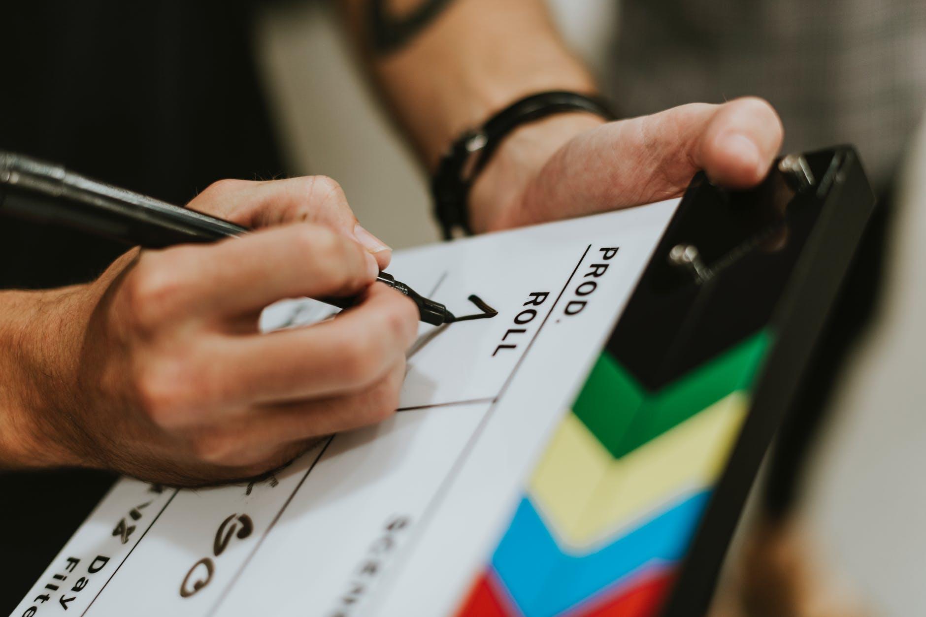 Clapperboard, slate, 1st AC, TV Studio production.